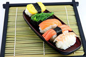 Seafoods Sushi in the dish. — Stock Photo