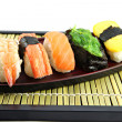 Seafoods Sushi on Black bamboo dish. — Stock Photo #26310401