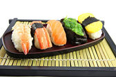 The seafoods Sushi on the Black bamboo dish. — Stock Photo
