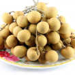 Fresh Longan tied together, placed in a dish. — Stock Photo