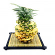 Picture pineapple slices stacked on a bamboo dish. — Stock Photo