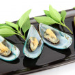 Stock Photo: Mussels on black dish.