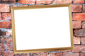 Gold frame on Brick Background of stone. — Stock Photo