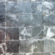 图库照片: Stone into squares same sort as background.