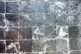 Stone into squares same sort as background. — 图库照片
