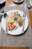 Photo of Rice Eggs bacon and toast breakfast. — Stock Photo