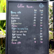Black wooden sign that indicates price of a coffee shop. — Foto de Stock