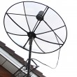 Satellite dish Stuck to roof of house. — Stock Photo