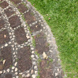 Boundaries between stones on grass in park. — Stock Photo #31162387