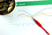 Pen resting on a Sales graph. — Stock Photo
