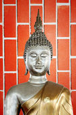 Buddha statue in the background of red Brick. — Stock Photo