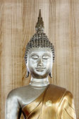 Buddha statue in the background of old wood. — Stock Photo