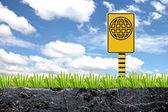 Yellow label with emblem world stuck it. — Stock Photo