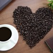 Coffee beans arranged in a heart shape, close to Coffee White an — Stock Photo #32546615