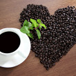 Coffee beans arranged in a heart shape, close to Coffee White an — Stock Photo #32546817