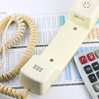 Telephone and calculator placed on Business graph. — Stock Photo #32600941