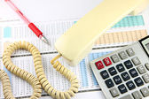 Telephone and calculator placed on Business graph. — Stock Photo