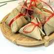 Dessert wrapped in banana leaves. — Stock Photo