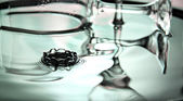 Green Background of wine glass in Basin and water drops. — Foto de Stock