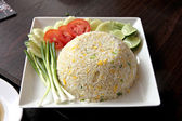 Fried rice in white dish on the Foods table. — Stock Photo