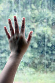 Hand on the mirror with water drops. — Stock Photo