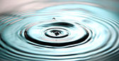 Blue Color of Water drops a beautiful shape in Basin. — Stock Photo