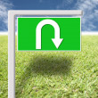 Green signs with arrows u-turn. — Stock Photo