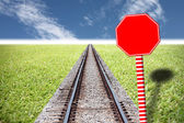 Railway traffic on the lawn and red Traffic signs. — Stock Photo