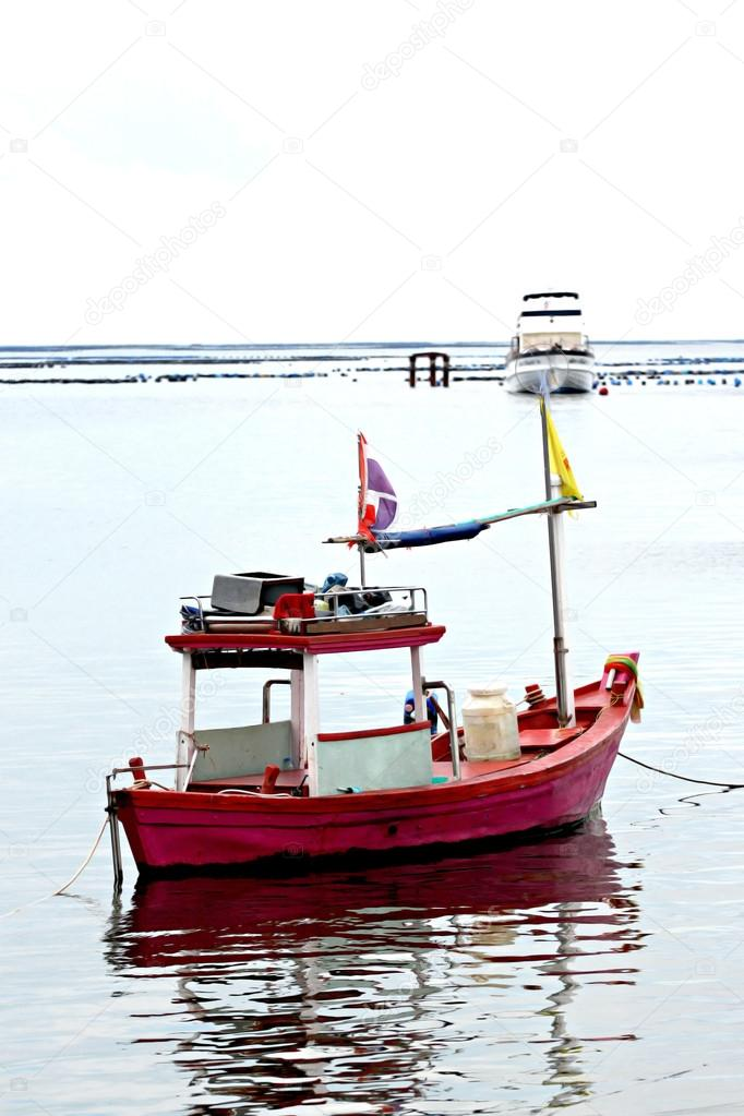 Small fishing boats stock photo meepoohyaphoto 35212897 for Small boats for fishing