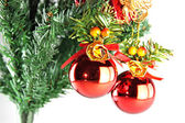 Red ball hanging on branch of Christmas tree. — Stockfoto