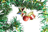 The Star,balls and drums hanging on Christmas tree. — Stock Photo