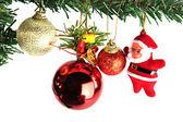 Red balls and Santa doll. — Foto de Stock