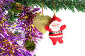 Santa hanging on Christmas tree. — Stock Photo