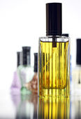 Many Bottle with Gold Perfume different color isolated. — Stock Photo