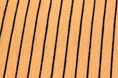Orange alternating black fabric. — Stock Photo