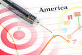 Mechanical pencil point to dot on America graph. — Foto de Stock