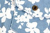 White flower pattern on blue fabric pocket. — Stock Photo