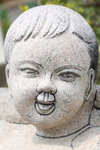 Chinese children of statues. — Stock Photo