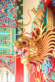 Gold dragon statue in Chinese temple. — Stock Photo