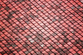 Red old tiles roof in the temple. — Stock Photo