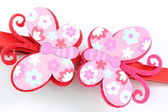 Pink of artificial butterfly hairpin isolated on white. — Stock Photo