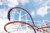 Rollercoaster against blue sky. — Stock Photo