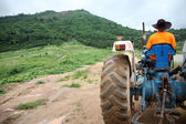 Farmer driving tractor. — Foto Stock