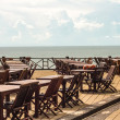 Tables restaurant on the ocean, the blue sky with clouds — Stock Photo