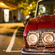 Red retro car, standing in the rain on a street — Stock Photo #24085837