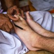 Balinese healer's hands to massage your legs — Stock Photo