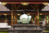 Gazebo in Temple Besakih with gold ornaments and trees — Stock Photo
