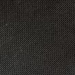 Stock Photo: High resolution texture of black cloth with holes in staggered r