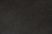 High resolution texture of black cloth with holes in staggered r — Stock Photo