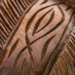 Ornament carved in dark wood in high definition - Stock Photo